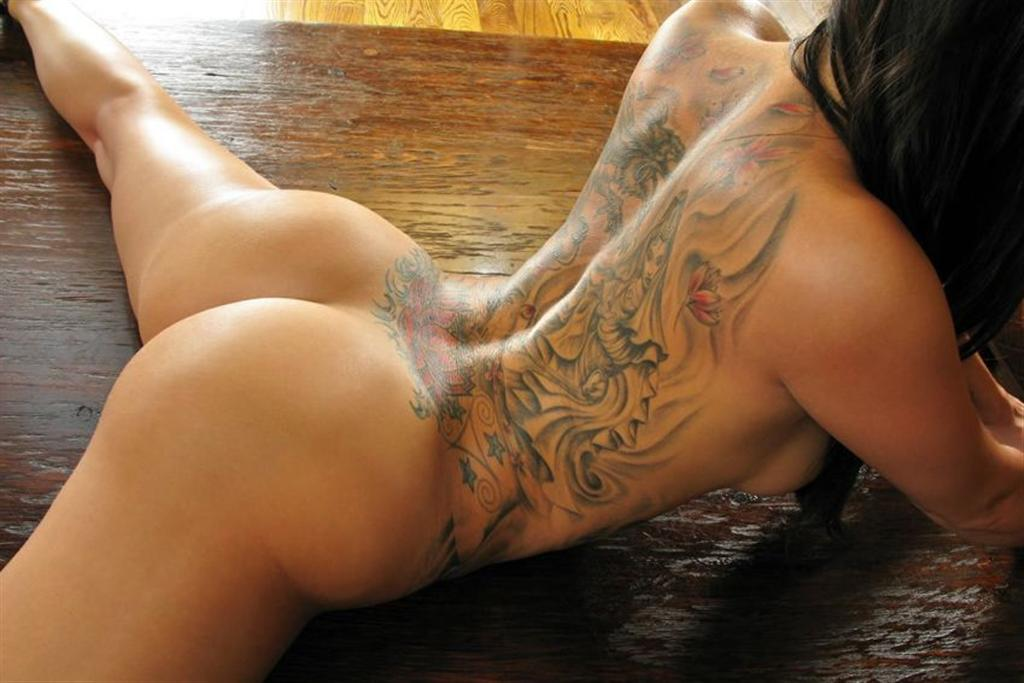 Tattooed girl spreads her legs
