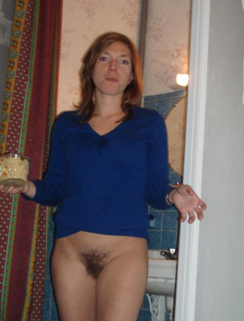 Amateur woman in blue blouse and in her bushy naked twat