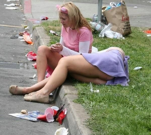 Very drunk chicks sleeping on the side walk
