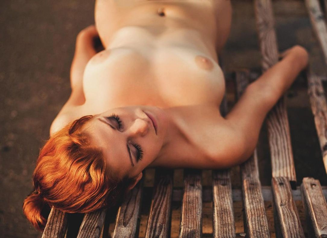Relaxing naked on a bench