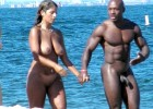 Horny couple walking naked on the sea shore