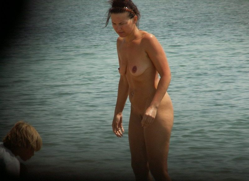 Nude milf on the beach exposed