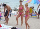 Pink bikini babes walking on hot beach sands