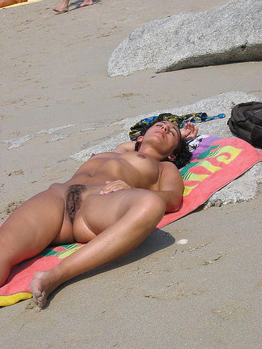 Sleeping babe expose her hairy slit in public