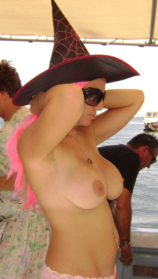 Topless hot babe wearing a witch hat