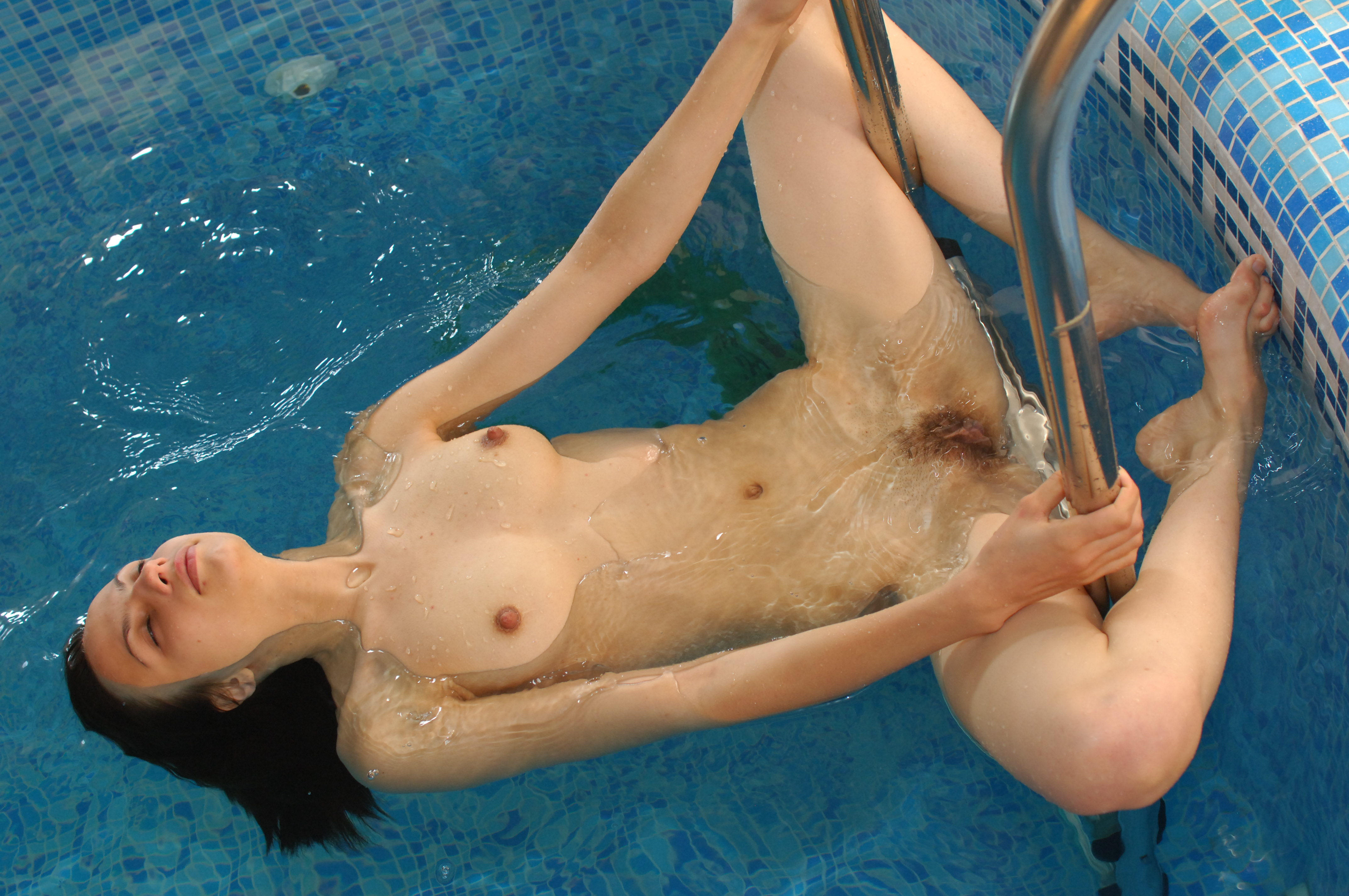 Naked girl gets naughty in the pool